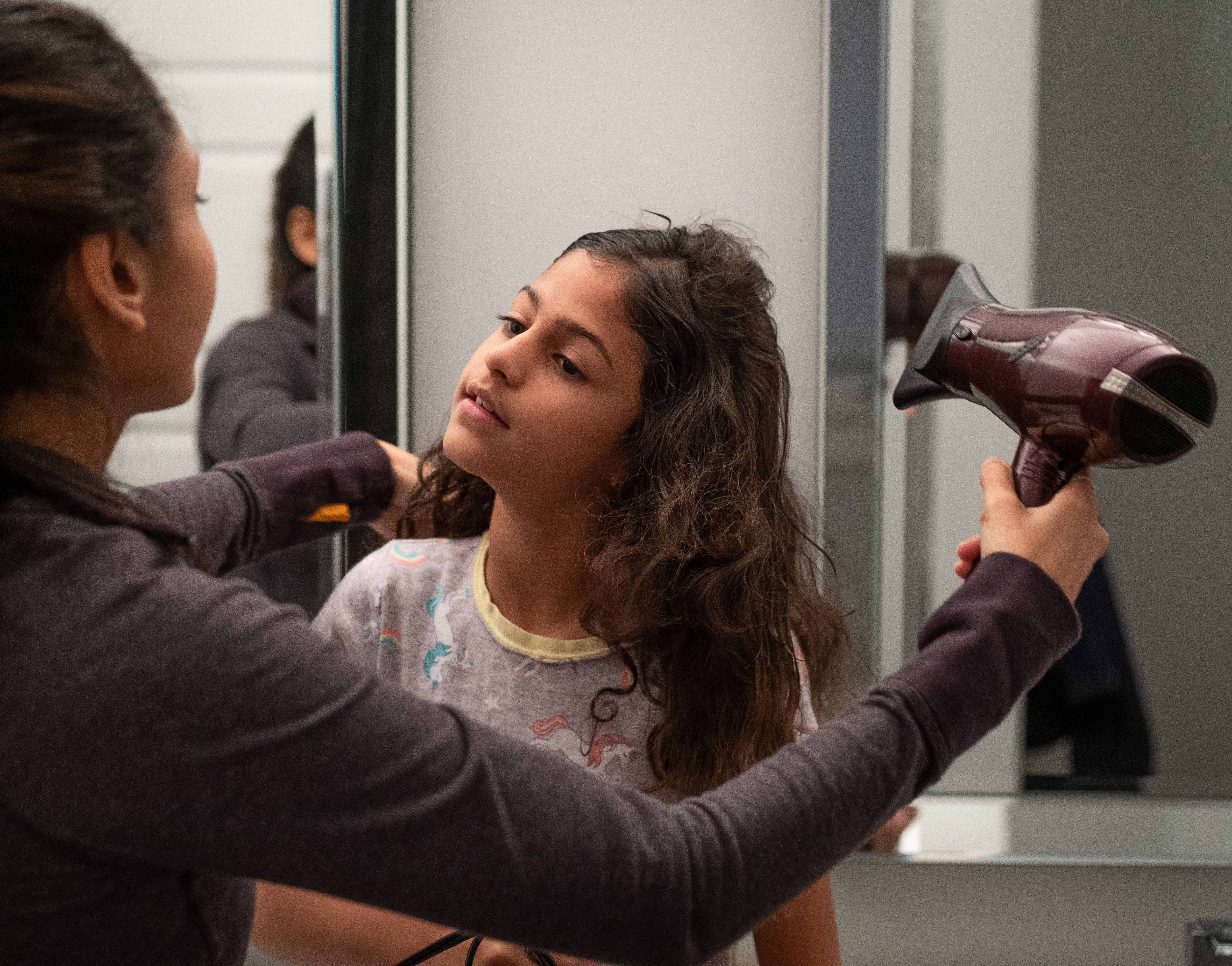 A girl getting her hair dryed