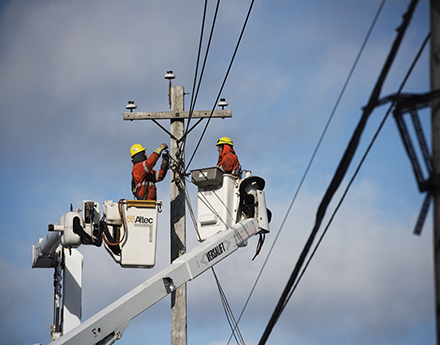 2 electrical engineers working on the lines