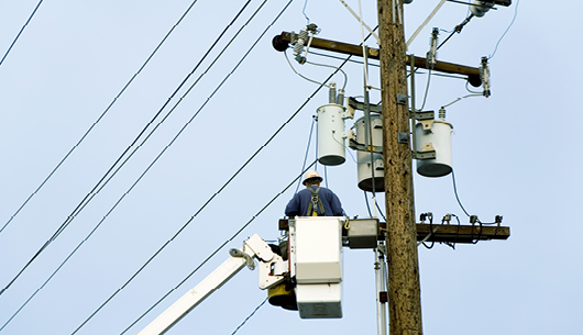 An electrical engineer working on the lines