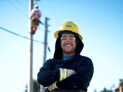 A NSP worker crossing his arms and smiling
